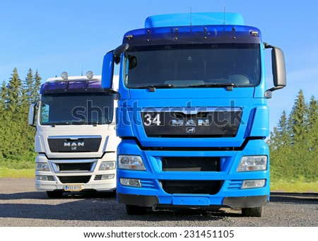 HYVINKAA, FINLAND - JUNE 28, 2014: White and Blue MAN Truck tractor parked. MAN obtains very good results from oekom research and Dow Jones Sustainability Index.