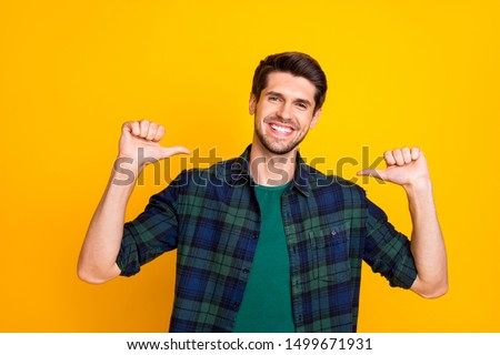 I am best! Photo of amazing guy indicating thumb fingers on himself wear casual checkered shirt isolated yellow color background