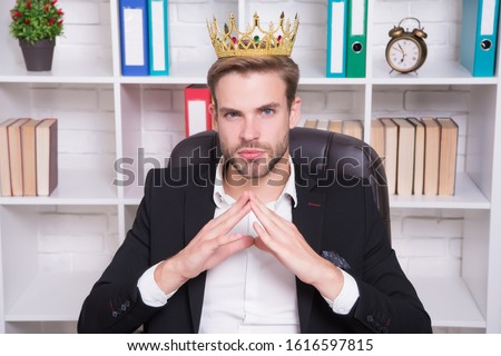 I am big boss here. Big boss in office. Big boss wear crown on head. Director or big boss. Confident businessman or ceo. Successful employer. Formal wear and work fashion. Follow your leader.