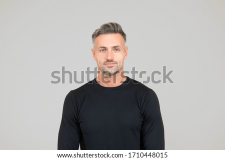 I am just man. Facial care and ageing. Attractive mature man. Mature guy with grey hair and bristle. Men get more attractive with age. Beauty of mature face. Male portrait concept. Perfect skin tone.