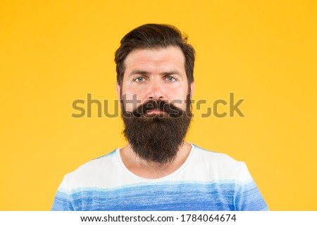 I am perfect. Barber tips maintain beard. Stylish beard and mustache care. Hipster appearance. Beard fashion and barber concept. Man bearded hipster stylish beard and mustache yellow background.