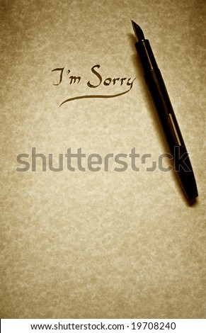 I Am Sorry Letter Being Written In Calligraphy On