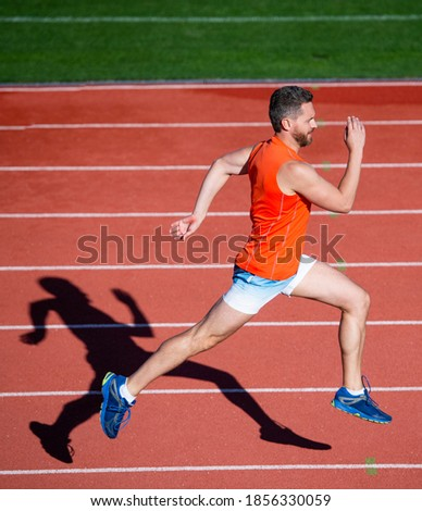 I am the best. athletic man compete in sprint. sport healthy lifestyle. fitness training outdoor. runner run fast on running track. energetic and sporty. marathon speed energy. muscular man in motion. Photo stock ©