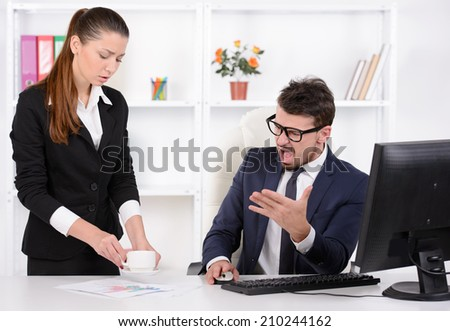 I asked to bring me tea! Stressed young businessman shouting at his secretary holding a cup of coffee