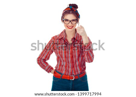 I choose you and order. The smiling business woman point you, want you, half length closeup portrait Closeup portrait of a beautiful girl in red checkered shirt, jeans with retro bow on head on white