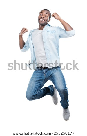 I did it! Full length of handsome young black man jumping against white background  #255250177