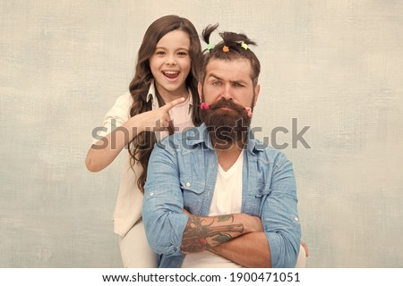 I did it. little girl made funny hairstyle for daddy. daughter and dad playing together. hairstylist her future career. father enjoying time with child. togetherness. spending time together at home.