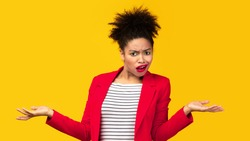 I Don't Know. Annoyed afro girl shrugging shoulders with spreaded hands, woman doesn't understand you, copyspace