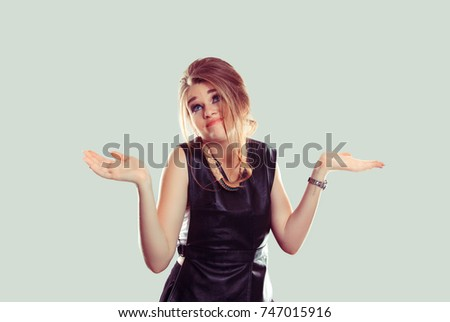 I don't know. Portrait dumb looking woman arms out shrugs shoulders who cares so what I don't know isolated on light green wall background. Negative human emotion, facial expression body language