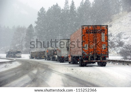 I-84, EASTERN OREGON - Jan 24 - Large trucks fight a winter storm  on the mountain highway   on Jan 24, 2012  in Eastern Oregon