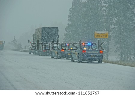 I-84, EASTERN OREGON - JAN 24 :Police cars stop to assist  a large truck during a winter storm  on Jan 24, 2012  in Eastern Oregon