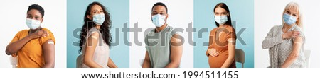 I Got My Coronavirus Vaccine. Smiling Multiethnic Patients In Medical Face Mask Showing Vaccinated Arm After Antiviral Injection For Covid-19 Protection, Posing On Studio Background, Looking At Camera