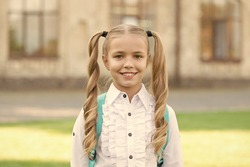 I got new rules. First day of school. Happy schoolgirl urban background. Little schoolgirl back to school. Small schoolgirl wear formal uniform. Charming look of cute schoolgirl. School and eduction