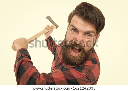 I hate it. Crazy man with axe isolated on white. Brutal lumberjack with crazy look. Bearded hipster in crazy mood threaten with axe. Crazy psycho.