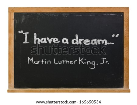I have a dream and Martin Luther King, Jr. written in white chalk on a black chalkboard isolated on white