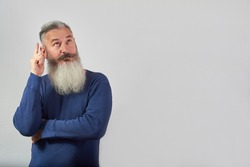I have an idea concept, portrait of mature gray-haired bearded man on gray background, selective focus