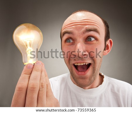 I have an idea! Surprised man holding lighting bulb