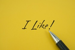 I Like! note with pen on yellow background