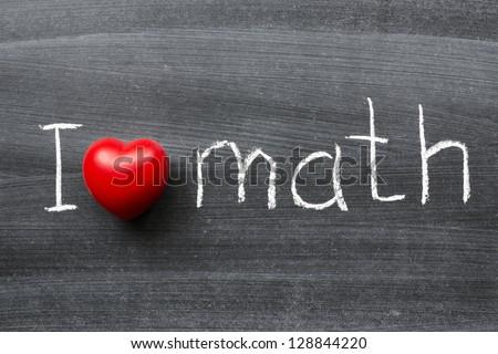 I love math phrase handwritten on the school blackboard - stock photo