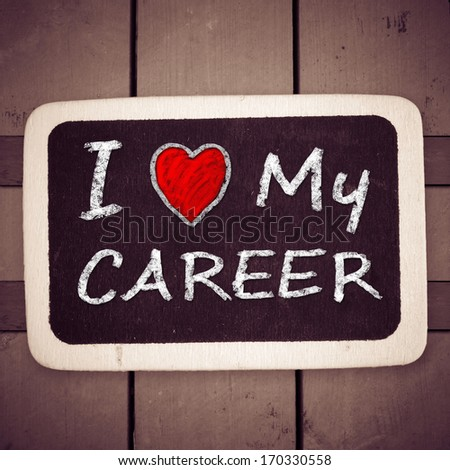 I love my career handwritten with white chalk on a blackboard on wood background