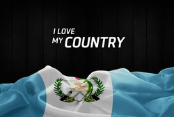 I Love My Country Guatemala flag and wood background