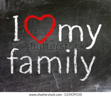 I love my family handwritten with white chalk on a blackboard.