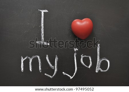 I love my job -  positive concept handwritten on black chalkboard with volume red heart symbol