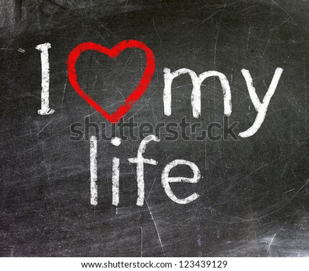 I love my life handwritten with white chalk on a blackboard.