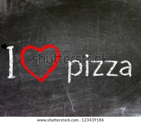 I love pizza handwritten with white chalk on a blackboard.