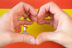 I love Spain. Hands make heart on Spanish flag background. 12 october national day of Spain, Hispanic Day, closeup