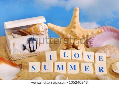 I love summer -text arranged with letter blocks on the beach