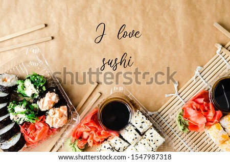 "I love sushi. picture with Japanese rolls and sushi with the inscription ""I love sushi"""