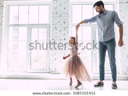 I love you, dad! Handsome young man is dancing at home with his little cute girl. Happy Father's Day! #1085101415