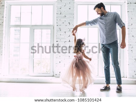 I love you, dad! Handsome young man is dancing at home with his little cute girl. Happy Father's Day! - Shutterstock ID 1085101424