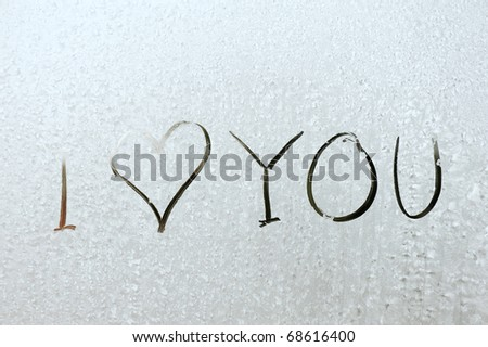 I love you! - on frozen window, happy lovers holidays