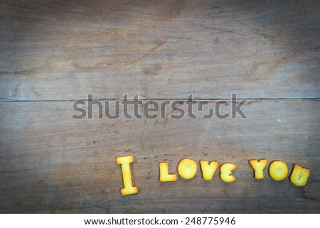 i love you text  by dessert on wooden background