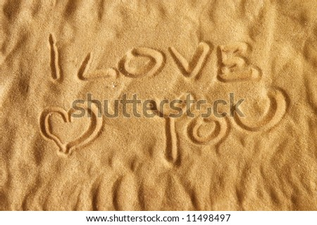 I love you written on sand with and soft focus for dreamy atmosphere