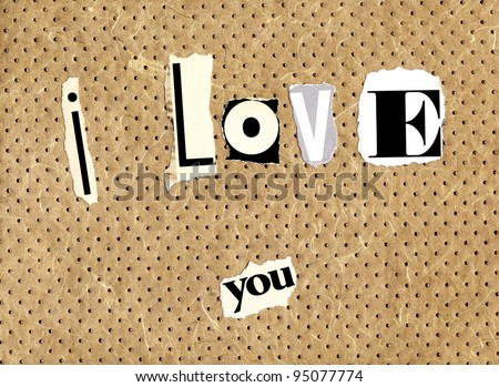 I love you written with newspaper and magazine cuts on a textured background