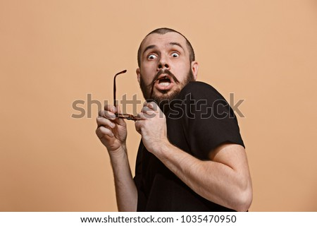 I'm afraid. Fright. Portrait of the scared man. Business man standing isolated on trendy pastel studio background. male half-length portrait. Human emotions, facial expression concept. Front view Stock photo ©