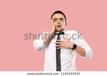 I'm afraid. Fright. Portrait of the scared man. Business man standing isolated on trendy pink studio background. male half-length portrait. Human emotions, facial expression concept. Front view Stock foto ©