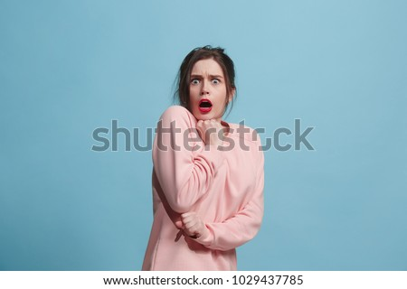 I'm afraid. Fright. Portrait of the scared woman. Business woman standing isolated on trendy blue studio background. Female half-length portrait. Human emotions, facial expression concept. Front view