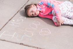 I miss school chalk sign in driveway.