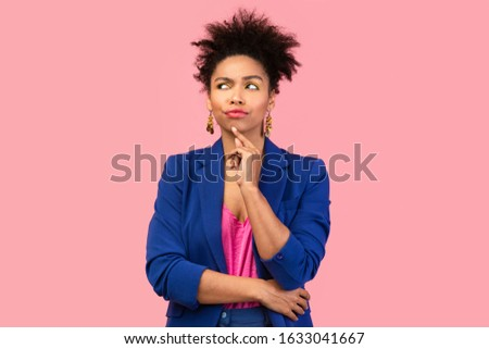 I Think. Pensive afro woman looking up, touching her chin, isolated over pink studio wall, copyspace