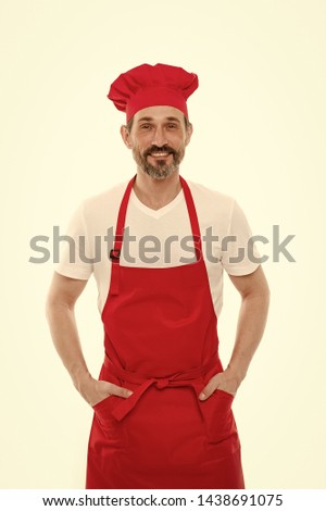I will clean and cook for you. Bearded mature man in chef hat and apron. Senior cook with beard and moustache wearing bib apron. Mature chief cook in red cooking apron. Home cooking. #1438691075
