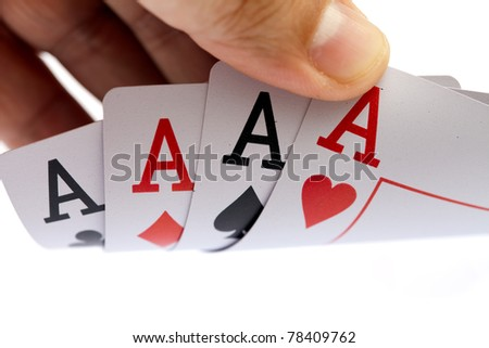 I win. Holding four aces, close up, on white background