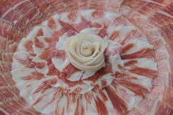 Iberian ham dish and rose