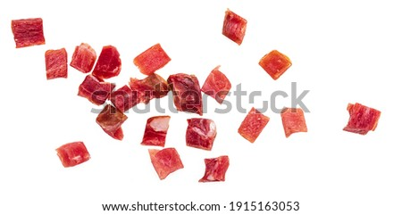 Iberian ham (serrano) cut into cubes (diced). Isolated on white background. Photo stock ©