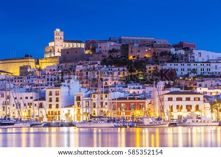 Ibiza Dalt Vila downtown at night with light reflections in the water, Ibiza, Spain.