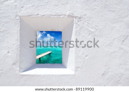 Ibiza mediterranean white wall window with Formentera beach view [photo-illustration]