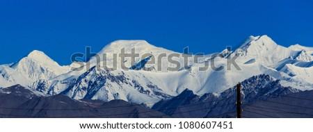 Ibn Sina (Avicenna) Peak, rises to 7,134 metres (23,406 ft) in Gorno-Badakhshan. View from Karakul Village.